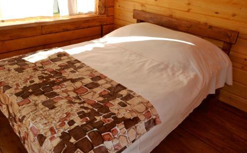 Кровать или кровати в номере База Отдыха Красные Ворота