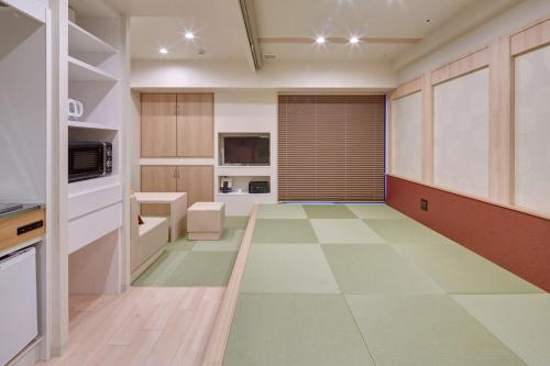 A kitchen or kitchenette at Hotel Amaterrace Yosuga