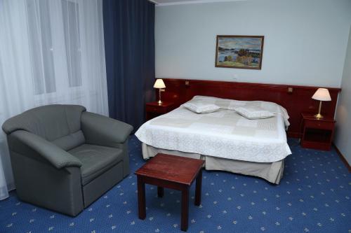 Ein Bett oder Betten in einem Zimmer der Unterkunft Draakon Hotel