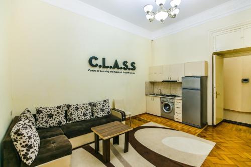 Uma área de estar em Сozy Apartment in the city center by Time Group