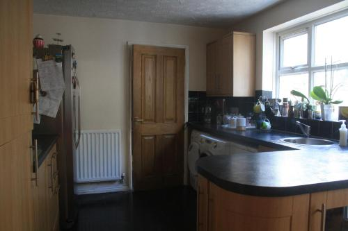 A kitchen or kitchenette at Coventry guest house room near Ricoh