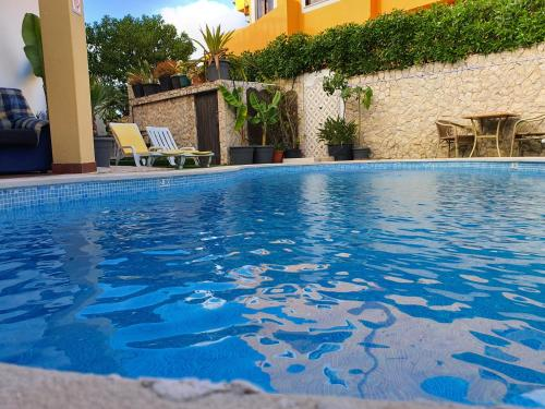 The swimming pool at or near Ocean View Lagos - Bed & Breakfast