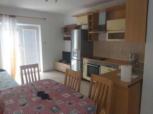 Kuchyň nebo kuchyňský kout v ubytování Apartment Mladinić Muse