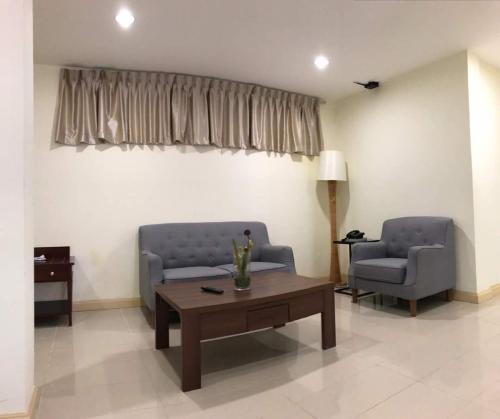 A seating area at The Capital Residence Suites