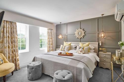 A bed or beds in a room at Burnham Beeches Hotel