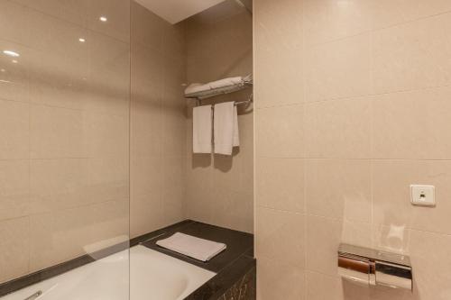 Een badkamer bij Shanghai Hotel Holland