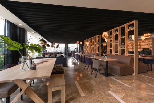 Een restaurant of ander eetgelegenheid bij Shanghai Hotel Holland