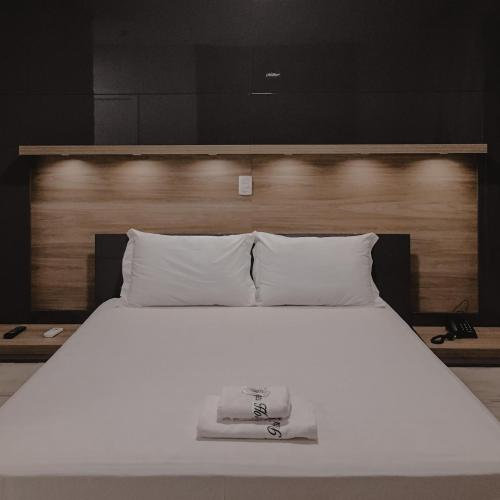 A bed or beds in a room at Petri Plaza Hotel