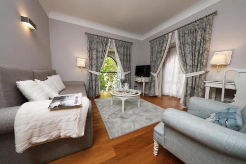 Uma área de estar em Grande Hotel das Caldas da Felgueira