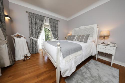 Uma cama ou camas num quarto em Grande Hotel das Caldas da Felgueira