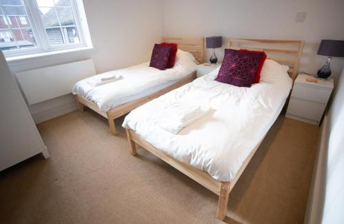 A bed or beds in a room at Comfort Stays - High Street