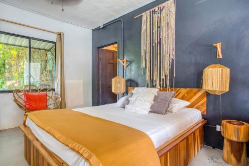 A bed or beds in a room at Selina Santa Teresa South