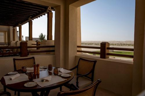 A restaurant or other place to eat at Al Wathba, a Luxury Collection Desert Resort & Spa, Abu Dhabi