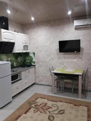 Кухня или мини-кухня в Apartamenty L.V