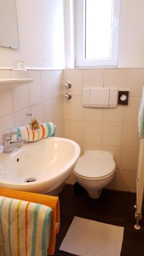 Ein Badezimmer in der Unterkunft Gästehaus am Sonnenhügel