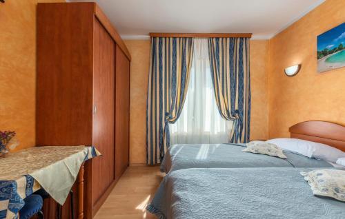 Letto o letti in una camera di Apartments and Rooms Laura