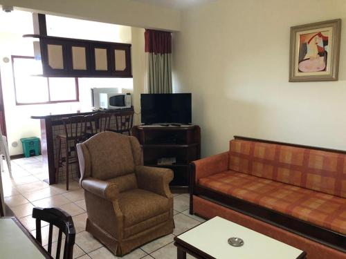 A seating area at Hotel Residencial Itapema