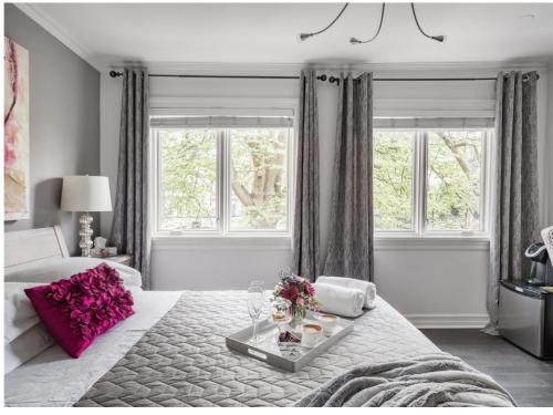 A bed or beds in a room at Downtown Luxury Victorian Retreat