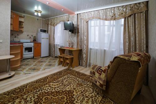 Гостиная зона в Apartment Kolya Myagotina 72