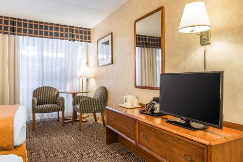 A television and/or entertainment center at Quality Inn & Conference Center - Springfield