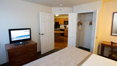 A bed or beds in a room at Candlewood Suites Springfield, an IHG Hotel