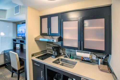 A kitchen or kitchenette at Staybridge Suites Denver Downtown, an IHG Hotel