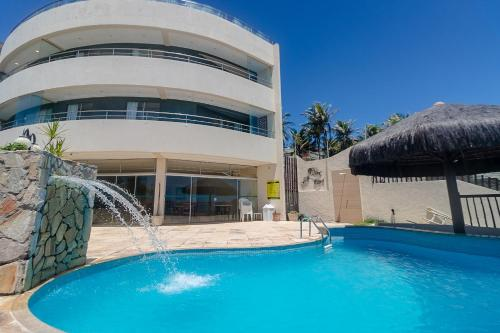 The swimming pool at or near Residence Vespucci Flat Beira Mar