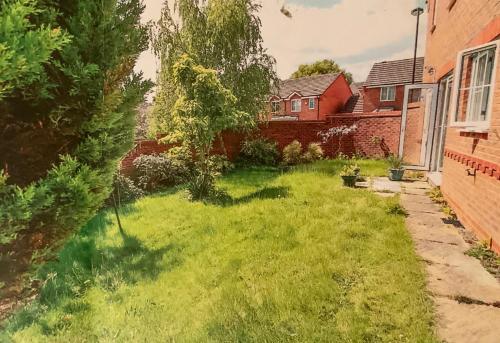 A garden outside Calm Bystream rooms