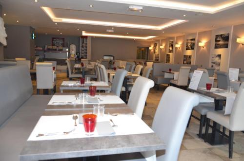 Restaurant ou autre lieu de restauration dans l'établissement La Table de Gustave