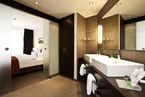 A bathroom at Atlantic Hotel Lübeck
