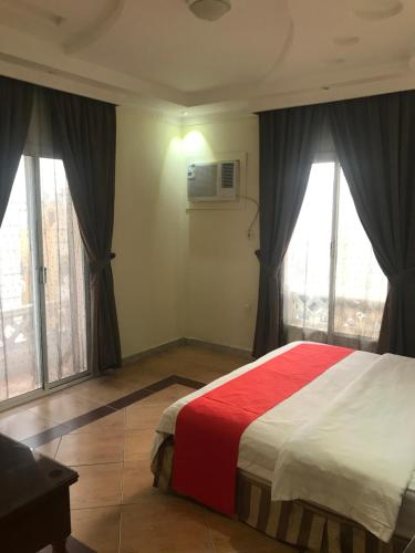 Cama ou camas em um quarto em Wasn Hotel Suites