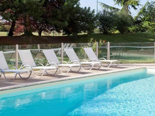 The swimming pool at or near Novotel Beaune