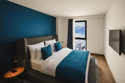 A bed or beds in a room at Gudauri Lodge