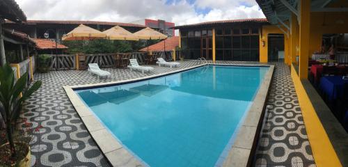 The swimming pool at or near Hotel Pousada Dos Ventos