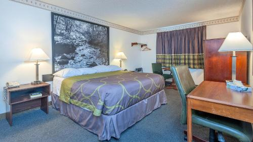 A bed or beds in a room at Super 8 by Wyndham Colorado Springs/Chestnut Street