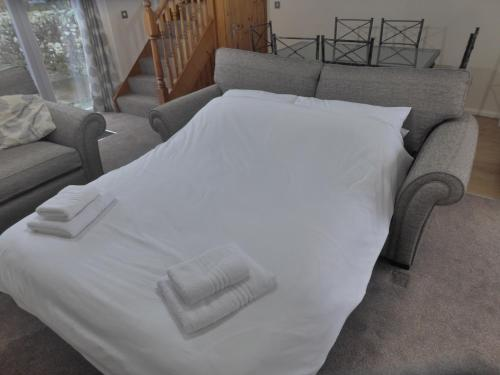 A bed or beds in a room at Green View Lodges