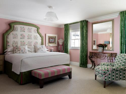 A bed or beds in a room at Haymarket Hotel, Firmdale Hotels