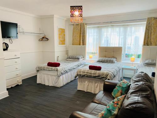 A bed or beds in a room at Circle Guest House