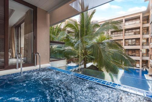 The swimming pool at or near Henann Lagoon Resort