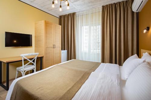 Кровать или кровати в номере Южная Дача
