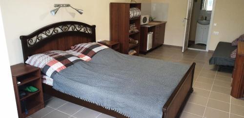 Кровать или кровати в номере Мотель Как Дома