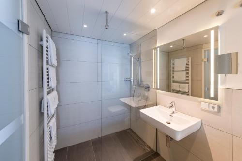 Ein Badezimmer in der Unterkunft Hotel Restaurant Lamm