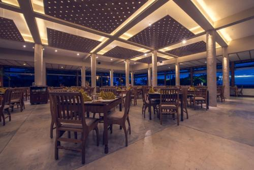A restaurant or other place to eat at Ranweli Holiday Village
