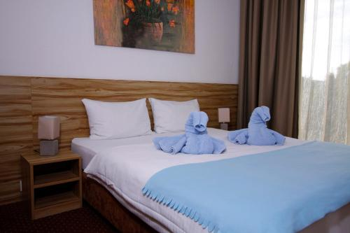 A bed or beds in a room at Aviator Garni Hotel Bratislava