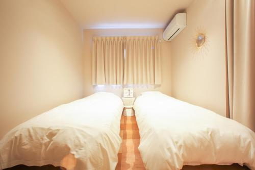 A bed or beds in a room at D3 Hotel 2F