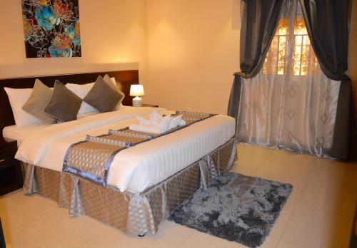 Cama ou camas em um quarto em West Liberty