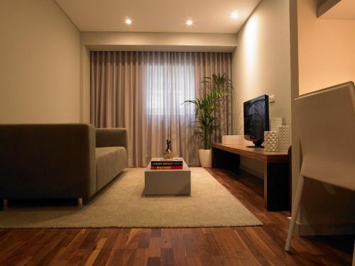 Uma área de estar em Altis Prime Hotel