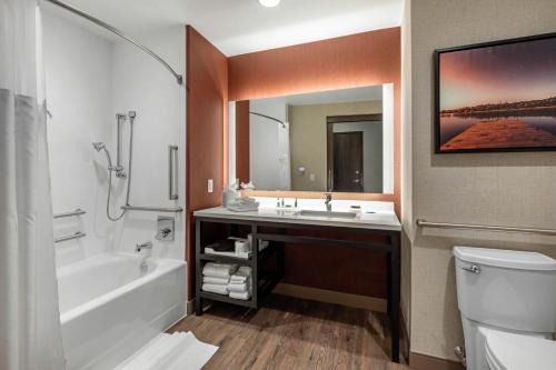 A bathroom at Cambria Hotel Omaha Downtown