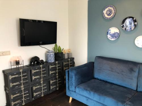 A television and/or entertainment center at Blue Harbour Appartement near Amsterdam