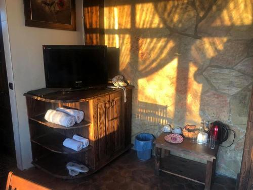 تلفاز و/أو أجهزة ترفيهية في فندق سانتا روزا
